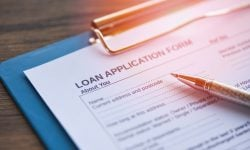 Loan application form with pen on paper / financial loan negotiation for lender and borrower on business document mortgage loan approval